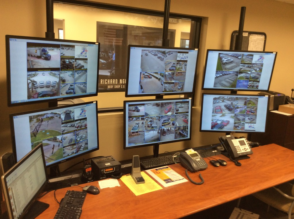 Service officers monitor video from multiple JM Lexus Family locations in the security operations center.